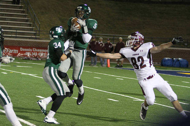 Edmond Santa Fe's Khari Harding intercepts a pass as Jenk's Sam Laptad (82) and Santa Fe's Conner Bays look on during the Edmond Santa Fe - Jenks game at UCO's Wantland Stadium in Edmond, Friday, November 18, 2011. PHOTO BY HUGH SCOTT, FOR THE OKLAHOMAN