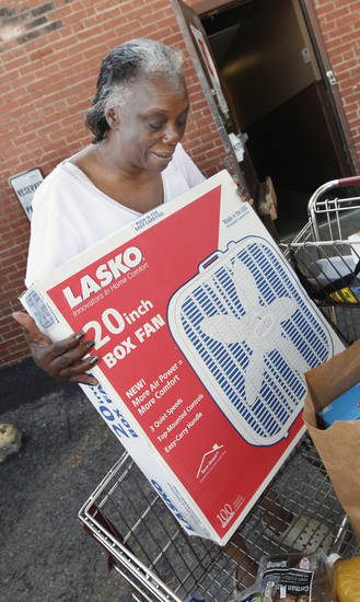 Carolyn Pollard, Okla. City, receiving a box fan from the Salvation Army after an Okla. Gas and Electric truck unloaded 300 box fans donated to the Salvation Army in Oklahoma City Thursday, June 20, 2013. Photo by Paul B. Southerland, The Oklahoman