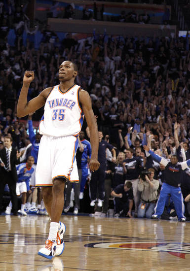 Oklahoma City's Kevin Durant (35) reacts after making 19-foot jumper the final minute of the NBA basketball game between the Denver Nuggets and the Oklahoma City Thunder in the first round of the NBA playoffs at the Oklahoma City Arena, Wednesday, April 27, 2011. Photo by Sarah Phipps, The Oklahoman