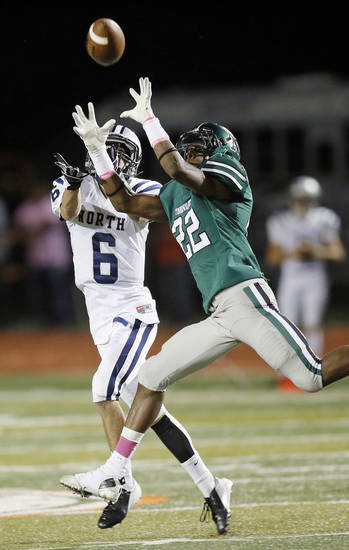 Norman North's Adim Chukwurah (22) deflects a pass intended for Edmond North's Robert Secrets (6) during a high school football game between Edmond North and Norman North in Norman, Okla., Thursday, Oct. 11, 2012. Photo by Nate Billings, The Oklahoman