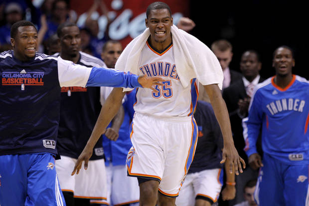 Oklahoma City's Kevin Durant (35) reacts beside Nate Robinson during game two of the Western Conference semifinals between the Memphis Grizzlies and the Oklahoma City Thunder in the NBA basketball playoffs at Oklahoma City Arena in Oklahoma City, Tuesday, May 3, 2011. Photo by Bryan Terry, The Oklahoman