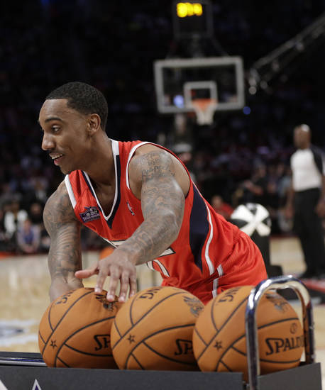 Jeff Teague of the Atlanta Hawks grabs a ball during the skills challenge in NBA basketball All-Star Saturday Night, Feb. 16, 2013, in Houston. (AP Photo/Eric Gay)