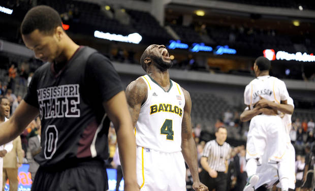 Baylor forward Quincy Acy (4) celebrates the Bears 54-52 win of after  NCAA college basketball game against Mississippi State, in Dallas, Wednesday, Dec. 28, 2011. (AP Photo/Matt Strasen) ORG XMIT: TXMS115