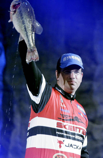 Angler Cliff Pace from Mississippi holds up the fish he caught during Saturday's weigh-in for the Bassmaster Classic at the BOK Center in Tulsa. PHOTO BY JAMES GIBBARD, TULSA WORLD