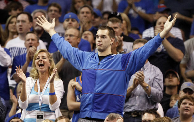 Fans react after a Thunder score during the NBA basketball game between the Miami Heat and the Oklahoma City Thunder at Chesapeake Energy Arena in Oklahoma City, Sunday, March 25, 2012. Photo by Nate Billings, The Oklahoman