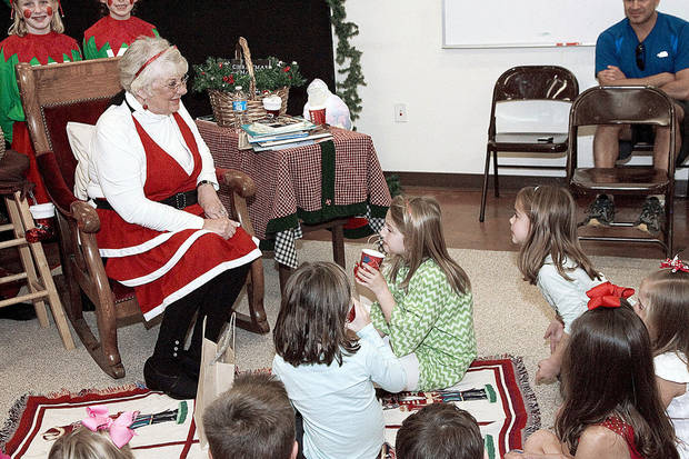 Mrs. Claus (Donna Cocoma) reading stories and talking to children while they drink hot chocolate at Santa&#039;s Art Workshop at the Edmond Fine Arts Instsitute. Photo by Steven N. Maupin, for The Oklahoman