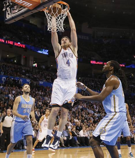 Oklahoma City's Nick Collison (4) dunks the ball in front of Denver's Evan Fournier (94) and Kenneth Faried (35) during the NBA basketball game between the Oklahoma City Thunder and the Denver Nuggets at the Chesapeake Energy Arena on Wednesday, Jan. 16, 2013, in Oklahoma City, Okla.  Photo by Chris Landsberger, The Oklahoman