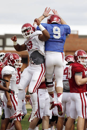 Linebacker Eric Striker (19) and quarterback Trevor Knight (9) jump and bump during Sooner spring football drills at University of Oklahoma (OU) on Tuesday, March 12, 2013 in Norman, Okla. Photo by Steve Sisney, The Oklahoman <strong>STEVE SISNEY</strong>