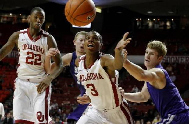 Oklahoma's Buddy Hield (3) goes for the ball beside Stephen F. Austin's Jacob Parker, left, and Thomas Walkup as Oklahoma's Amath M'Baye (22) watches during a college basketball game between the University of Oklahoma (OU) and Stephen F. Austin University at the Lloyd Noble Center in Norman, Okla., Tuesday, Dec. 18, 2012. Oklahoma lost 56-55. Photo by Bryan Terry, The Oklahoman