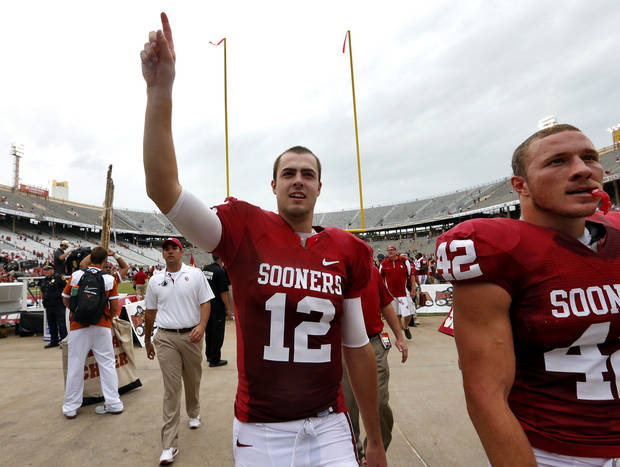 Landry Jones (12) salutes the fans as he leaves the field after the 63-21 win over Texas during the Red River Rivalry college football game between the University of Oklahoma (OU) and the University of Texas (UT) at the Cotton Bowl in Dallas, Saturday, Oct. 13, 2012. Photo by Chris Landsberger, The Oklahoman