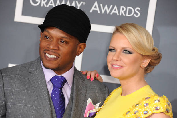Sway, left, and Carrie Keagan arrive at the 55th annual Grammy Awards on Sunday, Feb. 10, 2013, in Los Angeles.  (Photo by Jordan Strauss/Invision/AP) ORG XMIT: CADC106