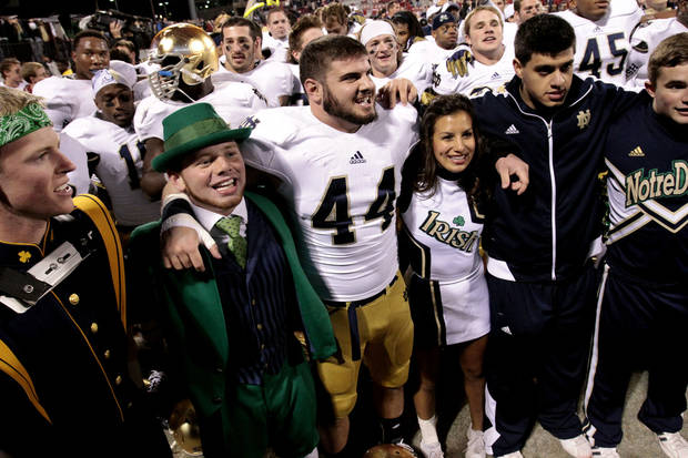 Notre Dame linebacker Carlo Calabrese (44) celebrates after the college football game where the University of Oklahoma Sooners (OU) were defeated by the Fighting Irish of Notre Dame (ND) 30-13 at Gaylord Family-Oklahoma Memorial Stadium in Norman, Okla., on Saturday, Oct. 27, 2012. Photo by Steve Sisney, The Oklahoman