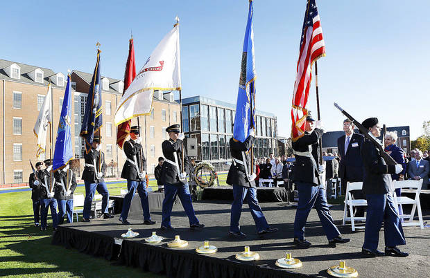The University of Oklahoma ROTC Color Guard steps onto the platform for the posting of the colors at the start of the ceremony. About 200 employees at Chesapeake Energy received commemorative coins during a Veterans Day ceremony Monday afternoon on the company�s campus in northwest Oklahoma City.   Photo by Jim Beckel, The Oklahoman