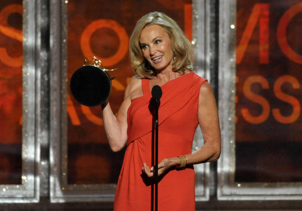 "Jessica Lange accepts the award for outstanding supporting actress in a miniseries for ""American Horror Story"" at the 64th Primetime Emmy Awards at the Nokia Theatre on Sunday, Sept. 23, 2012, in Los Angeles. (Photo by John Shearer/Invision/AP)"