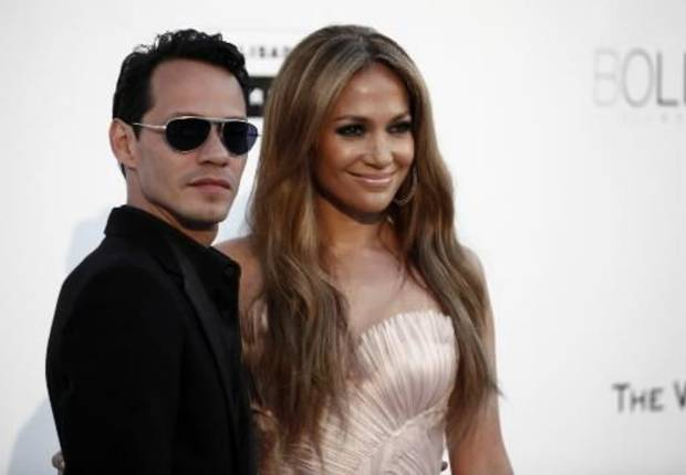 Singers  Marc  Anthony, left, and  Jennifer   Lopez arrive for the amfAR Cinema Against AIDS benefit at the Hotel du Cap-Eden-Roc, during the 63rd Cannes international film festival, in Cap d'Antibes, southern France, Thursday, May 20, 2010. (AP Photo/Matt Sayles)