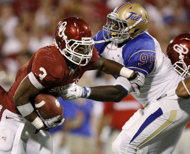 Oklahoma's Brennan Clay (3) runs past Tulsa's Tyrunn Walker (94) during the college football game between the University of Oklahoma Sooners ( OU) and the Tulsa University Hurricanes (TU) at the Gaylord Family-Memorial Stadium on Saturday, Sept. 3, 2011, in Norman, Okla. Photo by Bryan Terry, The Oklahoman ORG XMIT: KOD