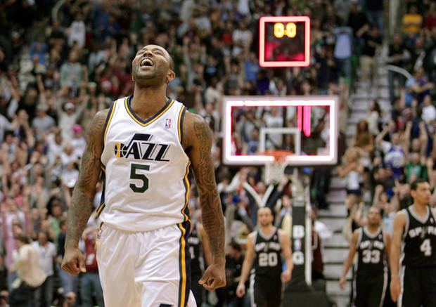 Utah Jazz point guard Mo Williams (5) celebrates after scoring the game-winning shot an the end of their NBA basketball game against the San Antonio Spurs Wednesday, Dec. 12, 2012, in Salt Lake City. The Jazz defeated the Spurs 99-96. (AP Photo/Rick Bowmer)