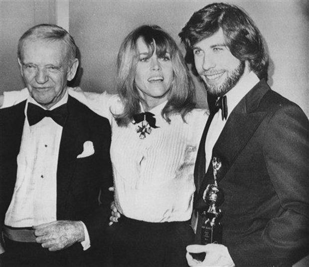 Actress Jane Fonda, center, is flanked by presenter Fred Astaire, left, and actor John Travolta at the 36th Golden Globes Awards Saturday night, January 28, 1979, in Hollywood.         (AP Photo)
