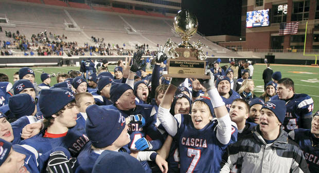 Cascia Hall fans, players and staff celebrate after the Class 3A Championship game at Boone Pickens Stadium, in Stillwater on Friday. Photo by CORY YOUNG, Tulsa World
