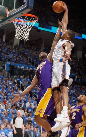 Oklahoma City's Russell Westbrook (0) dunks over L.A.'s Lamar Odom (7) during the basketball game between the Los Angeles Lakers and the Oklahoma City Thunder in the first round of the NBA playoffs at the Ford Center in Oklahoma City, Thursday, April 22, 2010. Photo by Sarah Phipps, The Oklahoman