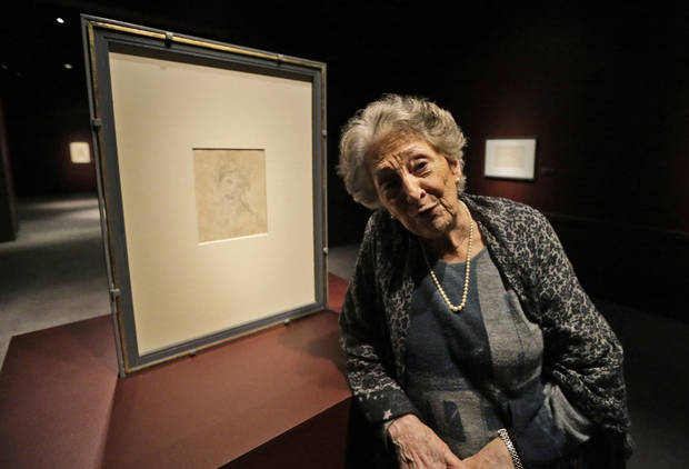 Director of the Casa Buonarroti museum in Florence, Italy, Pina Ragionieri in front of a Michelangelo drawing of Cleopatra  Wednesday, Feb. 6, 2013 in Williamsburg, Va. Twenty-five drawings by Michelangelo begin a two-city U.S. exhibition in Virginia on Saturday, Feb. 9, including some works never before seen in the United States and many that offer a glimpse into the mind of the master and the tumultuous times in which he lived. (AP Photo/Steve Helber)