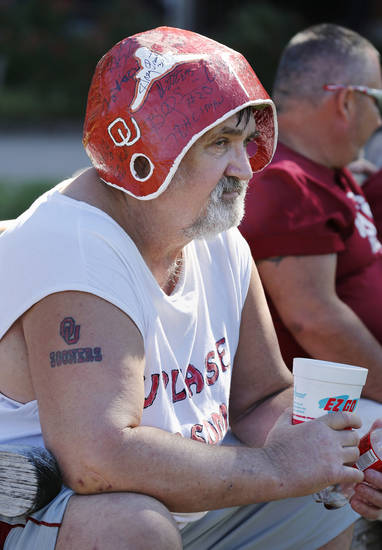 Ron Wallace, McAlester, sports a homemade autograph helmet as he waits outside the stadium for the college football game between the University of Oklahoma Sooners (OU) and Florida A&M Rattlers at Gaylord Family�Oklahoma Memorial Stadium in Norman, Okla., Saturday, Sept. 8, 2012. Photo by Steve Sisney, The Oklahoman