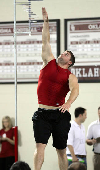 Ryan Reynolds shows his vertical leap at the University of Oklahoma (OU)'s football team's annual Pro Day workouts on Wednesday, March 14, 2012, in Norman, Okla.  Photo by Steve Sisney, The Oklahoman