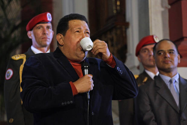 Venezuela's President Hugo Chavez sips coffee during an impromptu news conference with the foreign press at Miraflores palace in Caracas, Venezuela, Saturday, Oct. 6, 2012. Chavez is running for re-election against opposition candidate Henrique Capriles in Sunday's presidential election. (AP Photo/Ramon Espinosa)