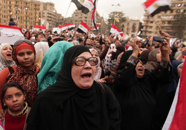 Protesters chant slogans in Tahrir Square in Cairo, Egypt, Tuesday, Dec. 4, 2012. A protest by tens of thousands of Egyptians outside the presidential palace in Cairo turned violent on Tuesday as tensions grew over Islamist President Mohammed Morsi's seizure of nearly unrestricted powers Thousands of protesters also gathered in Cairo's downtown Tahrir Square, miles away from the palace, to join several hundred who have been camping out there for nearly two weeks. (AP Photo/Maya Alleruzzo)