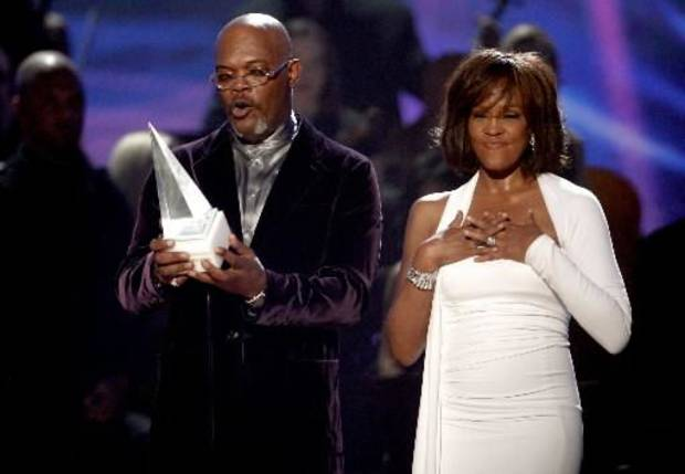 Samuel Jackson presents Whitney Houston with the International Artist Award at the American Music Awards. (AP Photo/Matt Sayles)