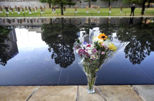A vase of fresh flowers sits next to the reflectiing pool during ceremony to remember and commemorate the 15th anniversary of the bombing  of the Alfred P. Murrah Federal Building. The flowers were later placed at the chair of a victim of the bombing. Hundreds, including relatives, friends and co-workers of the 168 people who died in the explosion, attended the 90 minute service at the Oklahoma City National Memorial on the site where the federal building once stood in downtown Oklahoma City, Monday, April 19, 2010.  Photo by Jim Beckel, The Oklahoman ORG XMIT: KOD