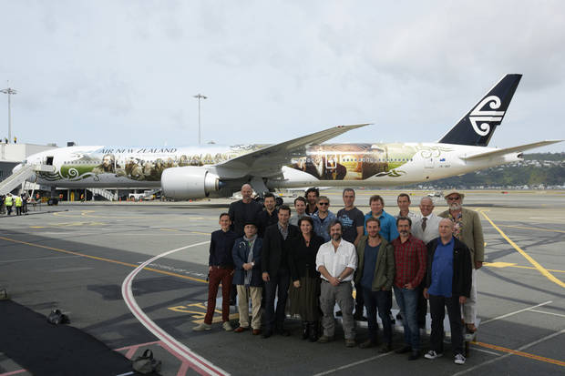 "This photo released by Air New Zealand shows cast and crew including Peter Jackson, front center, posing for a photo in front of a 777-300 aircraft decorated with scenes and characters from the soon to be released, ""The Hobbit: An Unexpected Journey,"" in Wellington, New Zealand, on Tuesday, Nov. 27, 2012. ""The Hobbit: An Unexpected Journey,"" the first movie in the planned $500 million trilogy, is scheduled to launch with a red-carpet premiere on Nov. 28 in Wellington and will open at theaters in the U.S. and around the world in December. (AP Photo/Air New Zealand) NO SALES"