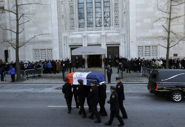 The casket containing the body of former New York City Mayor Ed Koch is brought into a synagogue for his funeral in New York, Monday, Feb. 4, 2013. Koch died Friday of congestive heart failure at age 88.  (AP Photo/Seth Wenig)