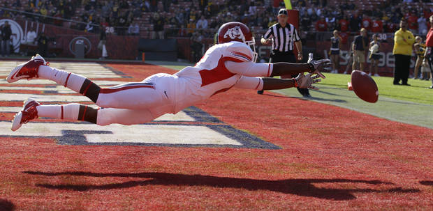 Fresno State wide receiver Jalen Saunders cannot catch a pass from quarterback Derek Carr in the second quarter of an NCAA college football game against California in San Francisco, Saturday, Sept. 3, 2011. (AP Photo/Jeff Chiu)