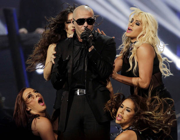 Rapper Pitbull performs during the halftime show of the NBA All-Star basketball game, Sunday, Feb. 26, 2012, in Orlando, Fla. (AP Photo/Chris O'Meara) ORG XMIT: DOA136