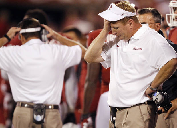 Mike Stoops reacts during the college football game between the University of Oklahoma Sooners (OU) and the Kansas State University Wildcats (KSU) at the Gaylord Family-Memorial Stadium on Saturday, Sept. 22, 2012, in Norman, Okla. Photo by Chris Landsberger, The Oklahoman