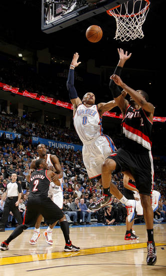 Oklahoma City's Russell Westbrook (0) shoots a lay up in front of Portland's LaMarcus Aldridge (12) during the NBA game between the Oklahoma City Thunder and the Portland Trailblazers, Sunday, March 27, 2011, at the Oklahoma City Arena. Photo by Sarah Phipps, The Oklahoman