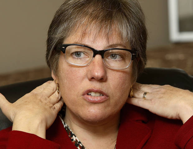 Elizabeth Caplan uses her hands to define the area of her neck that was injured by a treatment  performed by a chiropractor when she suffered a stroke.  Caplan sued the chiropractor after suffering a stroke while being treated at his practice.  She suffered some permanent injury from the stroke. She was photographed in Oklahoma City on Thursday, Nov. 29, 2012.   Photo by Jim Beckel, The Oklahoman