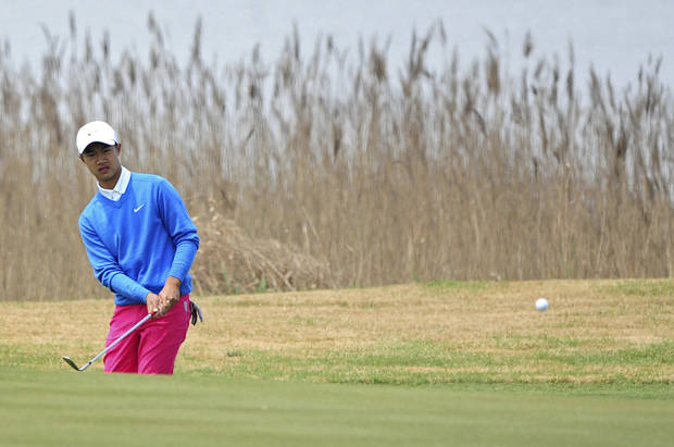 12-year-old Chinese amateur golfer Ye Wocheng watches his shot on the second day of the Volvo China Open at the Tianjin Binhai Lake Golf Club in north China's Tianjin Municipality Friday, May 3, 2013. Ye became the youngest player ever to compete in a European Tour event. (AP Photo) CHINA OUT