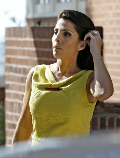   Jill Kelley leaves her home Monday, Nov 12, 2012 in Tampa, Fla. Kelley is identified as the woman who allegedly received harassing emails from Gen. David Petraeus&#039; paramour, Paula Broadwell. She serves as an unpaid social liaison to MacDill Air Force Base in Tampa, where the military&#039;s Central Command and Special Operations Command are located. (AP Photo/Chris O&#039;Meara)  