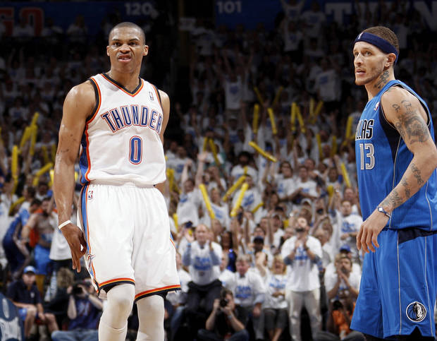 Oklahoma City's Russell Westbrook (0) reacts after hitting a three-point shot next to Dallas' Delonte West (13) during Game 2 of the first round in the NBA basketball  playoffs between the Oklahoma City Thunder and the Dallas Mavericks at Chesapeake Energy Arena in Oklahoma City, Monday, April 30, 2012.  Oklahoma City won, 102-99. Photo by Nate Billings, The Oklahoman