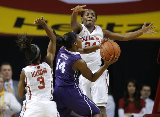 Oklahoma's Sharane Campbell (24) and Aaryn Ellenberg (3) defend TCU's Zahna Medley (14) during a women's college basketball game between the University of Oklahoma and TCU at the Llyod Noble Center in Norman, Okla., Wednesday, Jan. 30, 2013. Oklahoma won 74-53. Photo by Bryan Terry, The Oklahoman