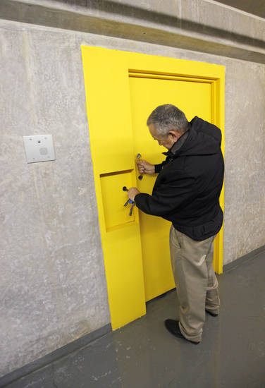 Dale Cantrell, a disciplinary hearing officer, closes the door to the death chamber on H Unit at the Oklahoma State Penitentiary in McAlester, Okla., Wednesday, Dec. 7, 2011. Photo by Nate Billings, The Oklahoman