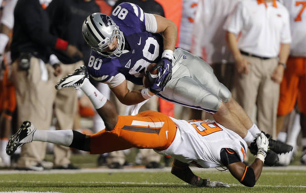 Brodrick Brown (19) trips up Kansas State's Travis Tannahill (80) during the college football game between the Oklahoma State University Cowboys (OSU) and the Kansas State University Wildcats (KSU) at Bill Snyder Family Football Stadium on Saturday, Nov. 1, 2012, in Manhattan, Kan. Photo by Chris Landsberger, The Oklahoman