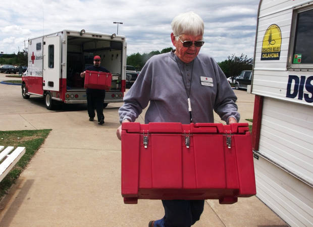 MAY 3, 1999 TORNADO: Donations: Charlie Walker, front, and Stephen Zajac with the American Red Cross unload heated food units after delivering meals to tornado survivors unable to cook .