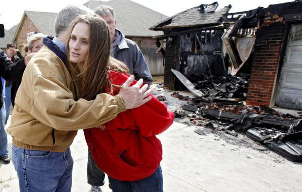 Gov. Brad Henry give a hug to homeowner Valerie Waxenfelter whose home was destroyed by wildfires on Friday, April 10, 2009, in Midwest City, Okla. while Henry toured the destruction in the Oakwood East Royale housing addition.   Photo by Chris Landsberger, The Oklahoman
