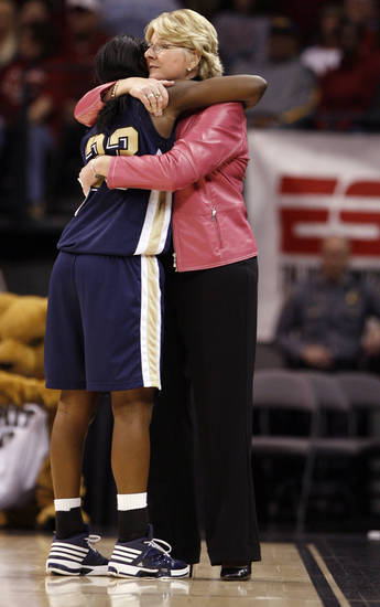 Pittsburgh head coach Agnus Berenato hugs Xenia Stewart as she fouls out in the second half of the NCAA women's basketball tournament game between the University of Oklahoma and Pittsburgh at the Ford Center in Oklahoma City, Okla. on Sunday, March 29, 2009. 