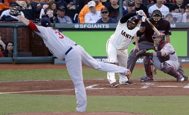 San Francisco Giants' Pablo Sandoval gets out of the way of a pitch from St. Louis Cardinals starting pitcher Lance Lynn during the first inning of Game 1 of baseball's National League championship series Sunday, Oct. 14, 2012, in San Francisco. (AP Photo/Mark Humphrey)