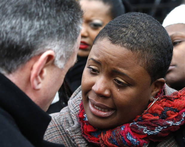 Cleopatra Pendelton cries as she talks with Chicago Police Superintendent Garry McCarthy before a news conference seeking help from the public in solving the murder of Pendelton's daughter Hadiya Wednesday, Jan. 30, 2013, in Chicago. Hadiya, 15, who had performed in President Barack Obama's inauguration festivities, was killed in a Chicago park as she talked with friends by a gunman who apparently was not even aiming at her. The city's 42nd slaying is part of Chicago's bloodiest January in more than a decade, following on the heels of 2012, which ended with more than 500 homicides for the first time since 2008. It also comes at a time when Obama, spurred by the Connecticut elementary school massacre in December, is actively pushing for tougher gun laws. (AP Photo/Charles Rex Arbogast)