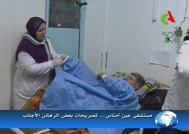 An unidentified rescued hostage receives treatment in a hospital in Ain Amenas, Algeria, in this image taken from television  Friday Jan. 18, 2013. Algeria�s state news service says nearly 100 out of 132 foreign hostages have been freed from a gas plant where Islamist militants had held them captive for three days.  The APS news agency report was an unexpected indication of both more hostages than had previously been reported and a potentially breakthrough development in what has been a bloody siege. (AP Photo/Canal Algerie  via Associated Press TV)  **  TV OUT   ALGERIA OUT  **